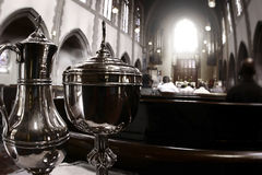 Photo of catholic church. During mass with close up of chalice Stock Photo