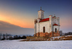 A photo of a catholic church in wintertime Stock Photos