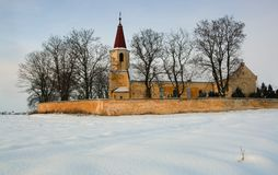 A photo of a catholic church in wintertime Royalty Free Stock Photos