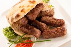 Photo of Cevapi, cevapcici, traditional  Balkan food - delicius. Minced meat Stock Image