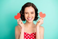 Photo of charming irresistible fascinating woman being definitely glad to have received paper cards hearts while