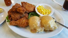 Photo Of Chicken Dinner With Corn And Mashed Potatoes. Beautifully prepared diner fried chicken dinner with mashed potatoes and gravy and corn Royalty Free Stock Images