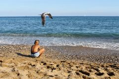 A child playing on a see coast stock image