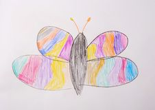 Photo of children`s drawing. Butterfly painted with colored pencils.