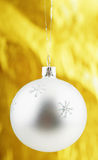 Photo of Christmas ball over golden background Stock Image