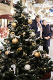 Photo of Christmas decorated New year tree with golden and white toys stock photography