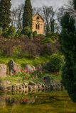 Photo of Church near little lake with tulips in the spring season Stock Photo