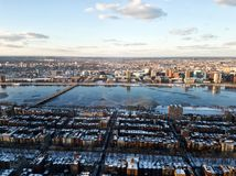 Cityscape of Boston and the Charles river in the evening in winter. Photo of the cityscape of Boston, MA, USA and the Charles river captured in the evening in Royalty Free Stock Photo