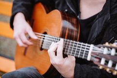 Guitar in man hads. Photo of classic guitar in man hads stock photo
