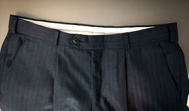 Photo of classic male trousers waist. Closeup photo of classic male trousers waist Stock Photography