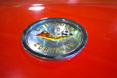Photo of classic vintage Chevrolet Corvette trunk Emblem. Stock Images