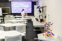 Photo of classroom for practicing chemistry with teacher stock photography