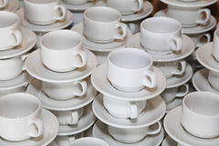 Photo closely standing diagonal rows together white porcelain mugs Royalty Free Stock Photo