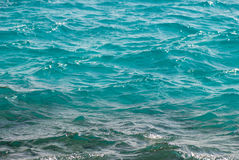 Photo closeup of beautiful clear turquoise sea ocean water surface with ripples low waves on seascape background. Horizontal picture Royalty Free Stock Image