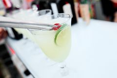 Cocktail with lime on the bar counter royalty free stock photo