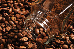 Photo of coffee beans and glass jar with instant coffee on brown background Royalty Free Stock Photography