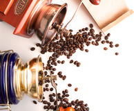 Photo with Coffee mills or grinder coffee grains on a white stud Stock Image