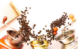 Photo with Coffee mills or grinder coffee grains on a white stud Stock Images