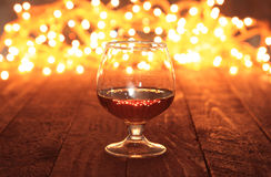 Photo cognac glass in front of bokeh background Stock Image