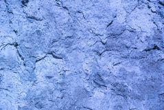 Photo of the cold blue colored rough weathered relief stucco wall texture. Best for background royalty free stock image