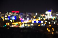 Photo of a cold night city. Beautiful Photography of a night city with a wide open aperture. It turned out a strong blur royalty free stock photo