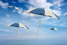 Flying umbrellas. Stock Images