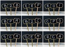 Photo collage of business acronyms written with chalk on wooden mini blackboard labels Stock Photos