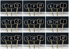 Photo collage of business acronyms written with chalk on wooden mini blackboard labels Stock Photography