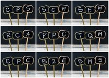Photo collage of business acronyms written with chalk on wooden mini blackboard labels royalty free illustration