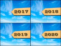 Photo collage of images with arrow over blue sky. Happy new year concept stock illustration