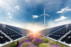 Photo collage of solar panels and wind turbin against the crops background Stock Photo