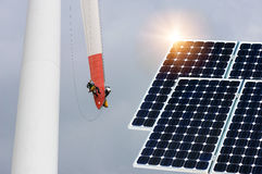 Photo collage of solar panels and wind turbines repair work Stock Photography