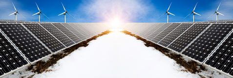 Photo collage of solar panels and wind turbins in winter with snow Royalty Free Stock Images