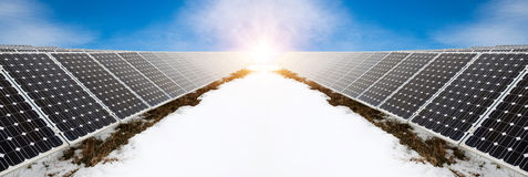 Photo collage of solar panels in winter with snow Stock Photo