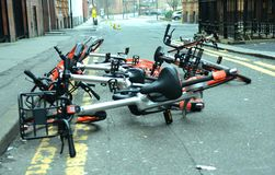 Photo of a collection of dumped Mobike cycle sharing bikes in a Stock Images