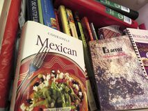 Mexican Cookbooks Filling the Shelf Royalty Free Stock Image