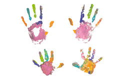 Photo of colored hand prints. Colorful hand prints of mother and kid on white background. Set of rainbow colored hand prints. Family concept royalty free stock photos