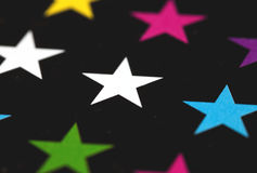 Photo of colored stars. On a black background Royalty Free Stock Images