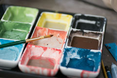 Photo of colorful and brush bright watercolor. In cuvettes Royalty Free Stock Image