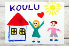 Drawing: Finnish word SCHOOL, school building and happy children. First day at school. Stock Images
