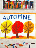 Drawing: French word Autumn and trees with red, yellow and orange leaves Stock Photos