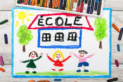 Photo of  colorful drawing: French word SCHOOL. School building and happy children. First day at school Stock Photo