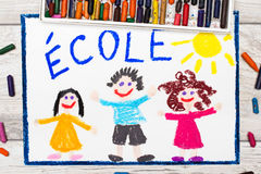 Photo of  colorful drawing: French word SCHOOL. Photo of colorful drawing: French word SCHOOL and happy children. First day at school Royalty Free Stock Photos