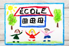 Drawing: French word SCHOOL, school building and happy children. First day at school. Photo of  colorful drawing: French word SCHOOL, school building and happy Stock Photo