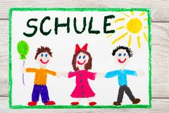 Drawing: German word SCHOOL and happy children. First day at school. Photo of  colorful drawing: German word SCHOOL and happy children. First day at school Stock Photos