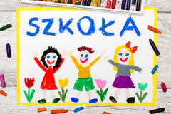 Photo of  colorful drawing: Polish word SCHOOL. School building and happy children. First day at school Stock Photos