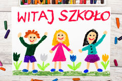 Photo of  colorful drawing: Polish word WELCOME TO SCHOOL,. Photo of  colorful drawing: Polish word WELCOME TO SCHOOL and happy children. First day at school Stock Photography
