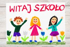 Drawing: Polish word WELCOME TO SCHOOL, school building and happy children. First day at school. Royalty Free Stock Photos