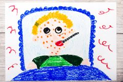 Drawing: sad sick boy lies in a bed. Boy with a rash on his face and a thermometer in his mouth. Photo of colorful drawing: sad sick boy lies in a bed. Boy with Royalty Free Stock Photography
