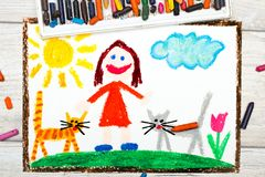 Drawing: Smiling little girl and her cute cats. Photo of colorful drawing: Smiling little girl and her cute cats Royalty Free Stock Image